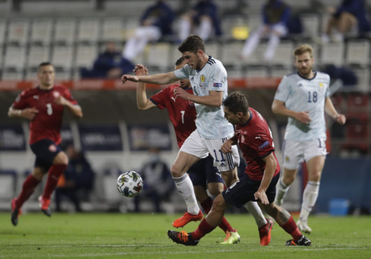 Scotland's Ryan Christie, centre controls the ball, as Czech Republic's players try to stop him.