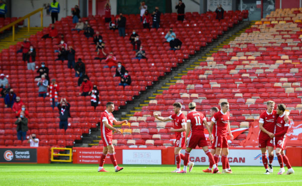 Aberdeen players and fans celebrate Ross McCrorie's goal against Kilmarnock.