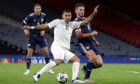Israel's Eitan Tibi (left) and Scotland's John McGinn battle for the ball