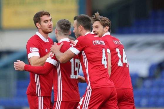 Aberdeen celebrate their third.