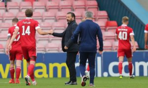 Derek McInnes shakes hands with his players after the game in Dingwall.