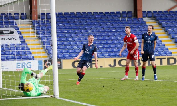 Marley Watkins watches his header beat Ross Laidlaw.
