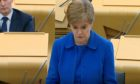 Nicola Sturgeon addressing the Scottish Parliament today.