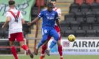 Isaac Layne of Peterhead challenges for the ball with Callum Fordyce of Airdrie.