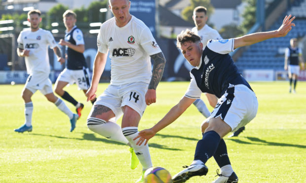 Josh Mulligan, right, playing for Dundee during pre-season.