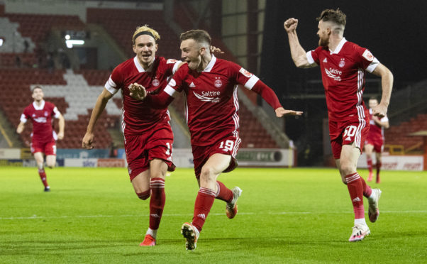 Lewis Ferguson, centre, celebrates after scoring the winner against St Mirren on Friday.
