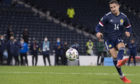 Kenny McLean scores the winning penalty for Scotland against Israel at Hampden.