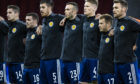 Considine, third from left, lines up for Scotland before the game on Sunday.