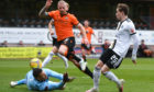 Aberdeen's Scott Wright chips the ball over Dundee United goalkeeper Benjamin Siegrist - only to be denied on the line.