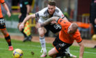Aberdeen's Marley Watkins, left, and Dundee United's Mark Connolly.