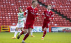 Lewis Ferguson celebrates scoring from the penalty spot to make it 3-3 against Celtic.