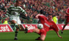 Celtic's Simon Donnelly (left) tries to get his cross past Aberdeen's Darren Young in 1998.