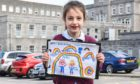 Seven-year-old Rose Donnelly with her thank you NHS drawing, which has been turned into a flag. Picture courtesy of University of Aberdeen/NHS Grampian