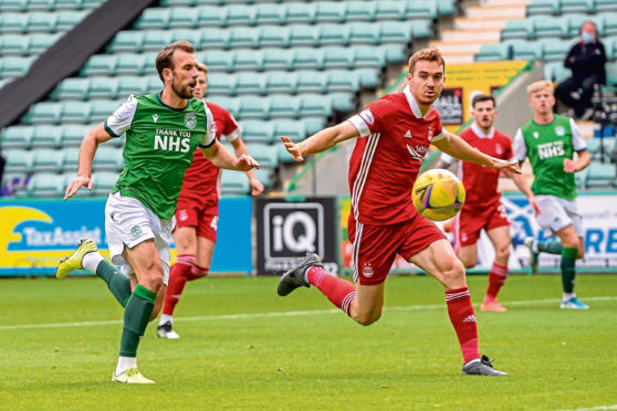 Hoban, right, shields the ball from Christian Doidge of Hibs.