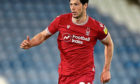 Former Aberdeen defender Scott McKenna is back in the Scotland squad after injury