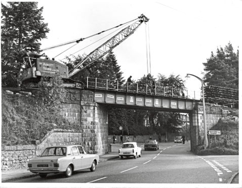 1970: With the approach of winter weather the contractors who are lifting the former Deeside railway line, W. H. Arnott, Young and Co. Ltd., groups and making an earlier start on removing the bridges along the line than was anticipated.