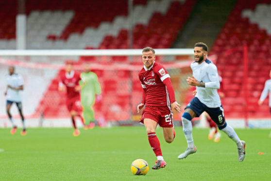 Bruce Anderson playing for the Aberdeen first team in the Premiership opener against Rangers.