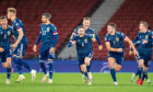 Scotland celebrate winning their penalty shoot-out against Israel.
