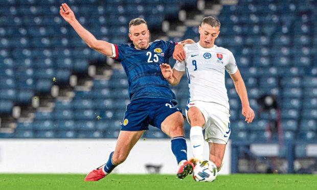 Andy Considine playing for Scotland against Slovakia.