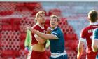 Aberdeen defender Tommie Hoban and Motherwell's Jordan White challenge for the ball.