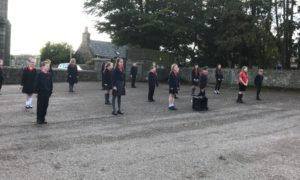 Children from New Deer Primary School practicing for the A Song for Haddo concert which took place last week