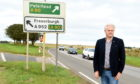 Councillor for Peterhead and Cruden Alan Fakely is calling for improvements on roads north of Toll of Birness following a discussion on a Nestrans report at a council meeting.