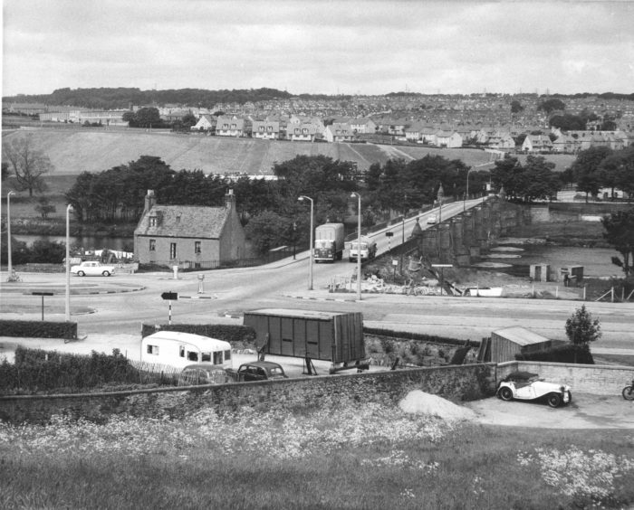 1964: A view of the old Bridge of Dee, Aberdeen, looking north from Kincorth towards Kaimhill, as it was in this picture from June 1964. The volume of traffic was very light with only four vehicles in the photograph.