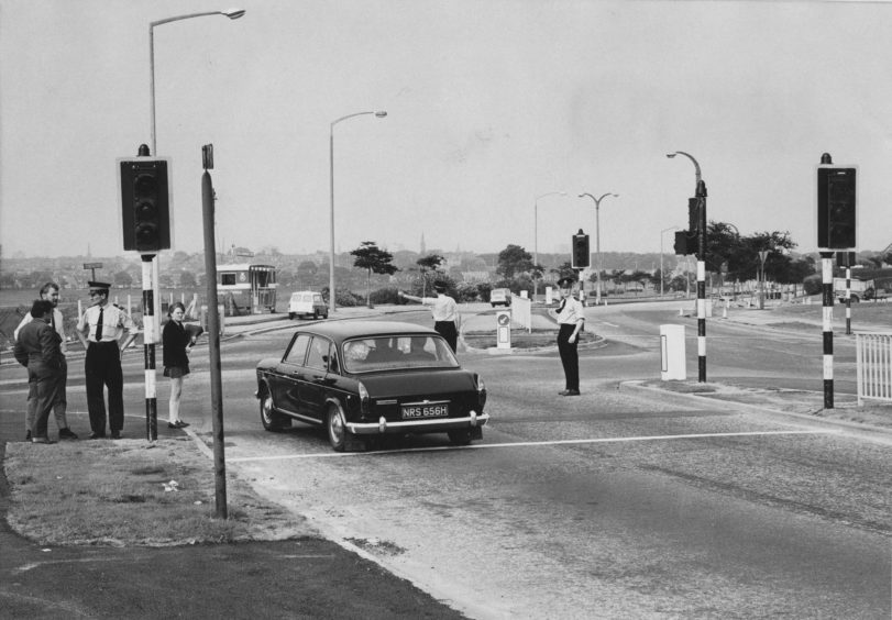 1971: Police were out in force at the Bridge of Dee, Aberdeen, yesterday afternoon when the new traffic lights were in operation for the first time.