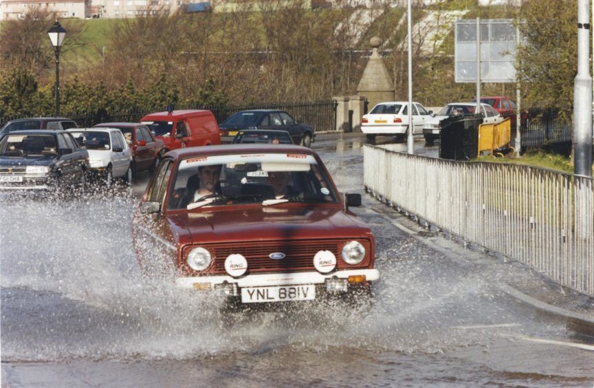 1991: Making a splash: Cars this morning at the Bridge of Dee, Aberdeen.