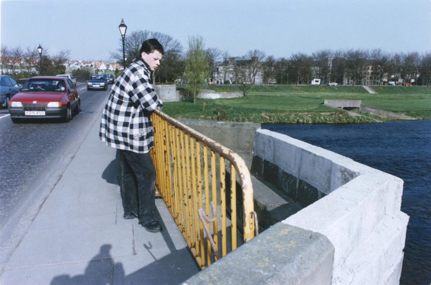 1993: Art and Design student Graeme Robertson, Inverness, looks at the parapet at Bridge of Dee.