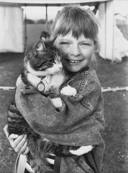 1986: Joy Mennie with her cat Kizzy, first in the cats section at Cove Bay Gala pets parade.