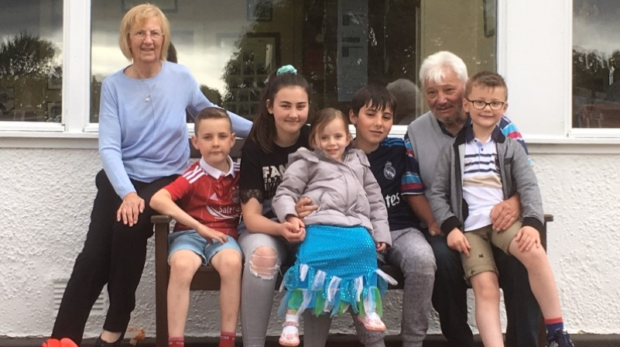 Pictured is Dave Johnstone with wife Susan and, from left, their grandchildren Liam, Lilly, Aimee, Andrew and Blair.