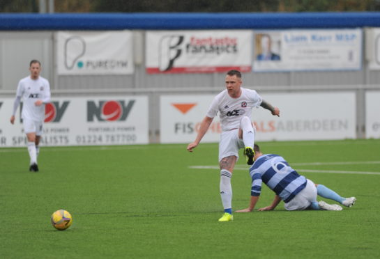 Ryan Strachan in action for Cove.