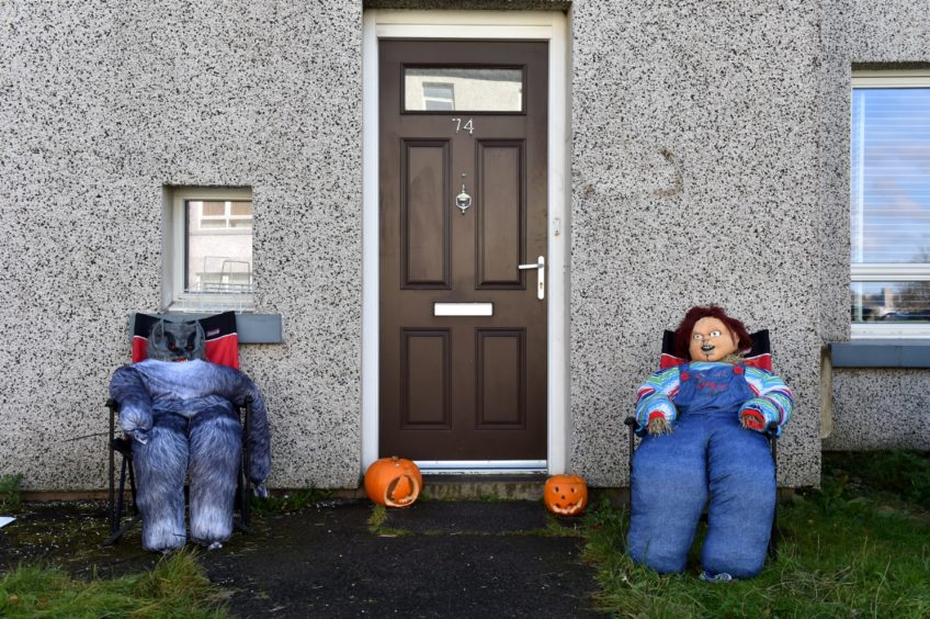 Scooby Doo-themed scarecrows.