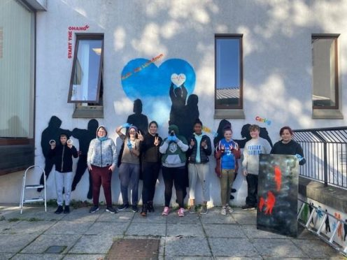 The teenagers involved in the mural project.