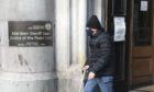 George McIntosh leaving Aberdeen Sheriff Court