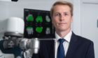 Martin Mitchell, Consultant orthopaedic surgeon at BMI Albyn Hospital with the robotic arm