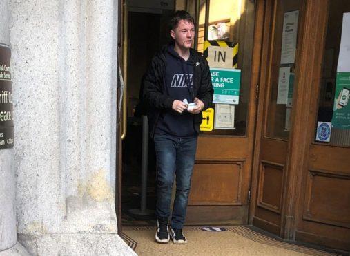 Derek McGanley leaving court.