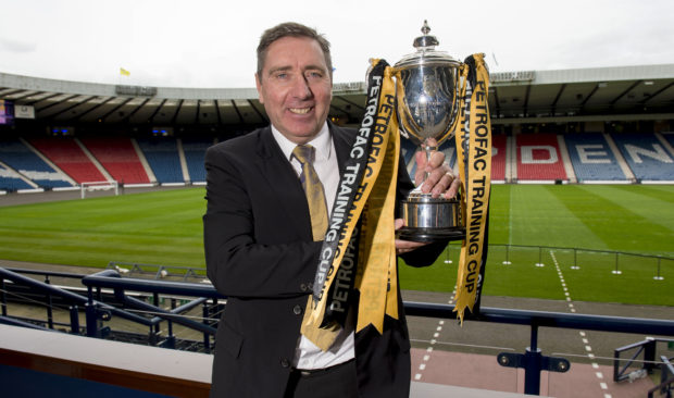 Peterhead manager Jim McInally with the Challenge Cup trophy