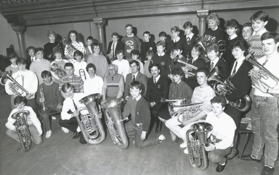 1987: Members of Aberdeen Music Centre Senior Brass Band who leave on June 8 for a ten day visit to Denmark in an exchange visit with the Music Centre in Skjern, West Jutland. The band will play in five concerts which will include playing for the mayor of Skjern, where they will be staying, Legoland and Stauning Airport which is holding a vintage aircraft exhibition. In the party are James Anderson, adviser in music, Stewart Watson, conductor, Moira Ross and Eric Kidd (brass instructors) and 36 band members. This is the first time the brass band has played abroad and is the first leg of the exchange with the musicians in Skjern who will be here next summer possibly during the Bon-Accord Festival.