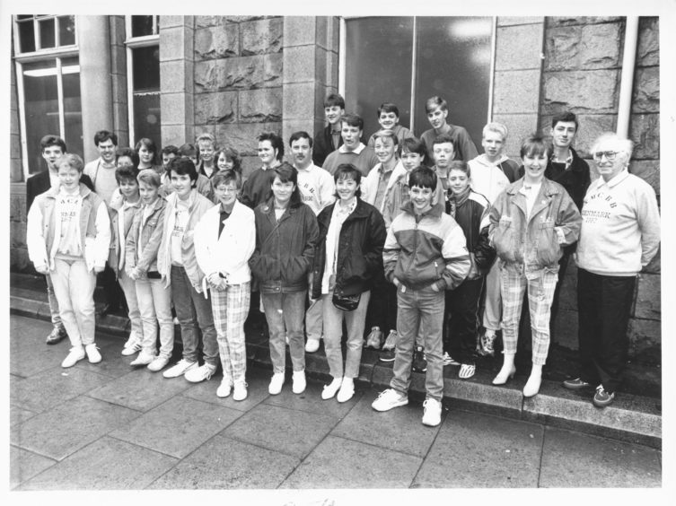 1987: Aberdeen Music Centre brass band members with their conductor Mr Stewart Watson before leaving for a 10 day tour in Denmark today.