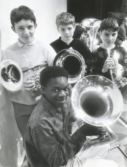 1988: Taking a break from rehearsal are members of the Aberdeen Music Centre Brass Band, who are attending their annual residential course at Aboyne Community Centre. They are (back, left to right): Gordon Murison, Powis Academy; David [Handerson], Kincorth Academy; David Harris, Aberdeen Grammar School, all Aberdeen; with (in front) Paul Collins, Portlethen, who attends Mackie Academy.