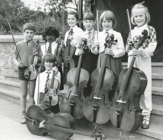 1988: Young musicians from Grampian schools show off the results of Operation Pintsize - a fund raising drive by the St Nicholas Centre in Aberdeen to buy half size violins and cellos for the city's Music Resources Centre after yesterday's presentation at the centre bandstand. Lisa Yule, Airyhall primary, kneels in front of, left to right, Christopher Sharp, Shankari Nanthakumaran, Catherine Coutts, all Airyhall primary, Mhairi Mackay, Broomhill, Sonia Cromarty, Hazlehead, Esther Anderson, Kittybrewster.