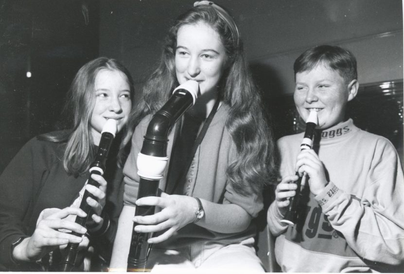 1992: Members of the recorder group (from left) Debbie Norris (14), Sarah Ewan (13) and Barry Allan (13) find it hard to practise and pose for the camera at the same time.