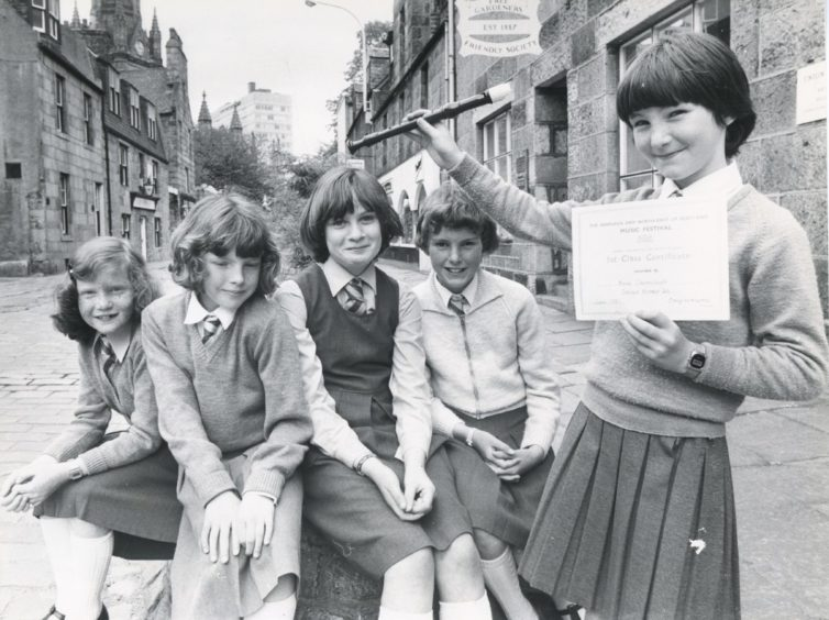 1981: Proud moment for Stonehaven girl Ann Cairnduff as she holds up her certificate after winning the under 10 solo descant recorder section yesterday. Looking on are schoolfriends who also competed (left to right) Sandra Lonie, Nicky Fraser, Jennifer Crabb and Fiona Ingram (all Stonehaven).