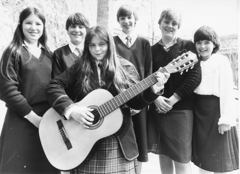1982: Winner of the guitar competition for 14 years and under, Suzanne Morrow (centre) Westhill, is joined by fellow competitors (left to right) Ronay Thomson, Karen Taylor, Lesley Mitchel, Julie Tosh and Yvonne McLaren, all Aberdeen.