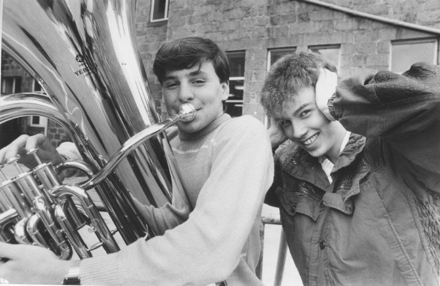 1985: Martin Burgess, Ellon, gets a friendly ribbing from fellow tuba player Stuart Presly, Oldmeldrum, after winning the Under 18 Class.