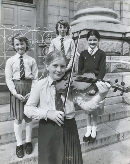1986: Winner of the violin (10 and under) section in the Aberdeen and North East of Scotland Music Festival, Katie Sarah Jones, Ellon Primary, strikes a winning pose with runners up, from left, Louise Cumming and Angela Bell, both Auchterellon, who were second equal and third placed Linnea Nicol, Hazlehead.