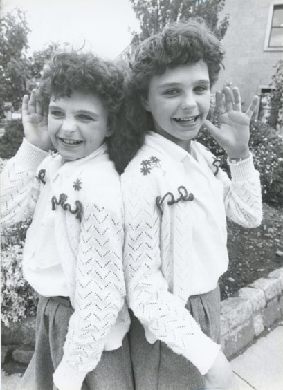 1987: Twins Stephanie and Sara Brown, Fraserburgh, ready to take part in the under 12 Scots song section.