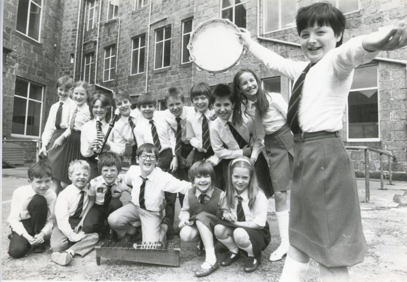 1987: Foveran School, Newburgh, came first in the group music making competition yesterday at the Aberdeen and North East Scotland Music Festival. Moira Black shakes the tambourine.